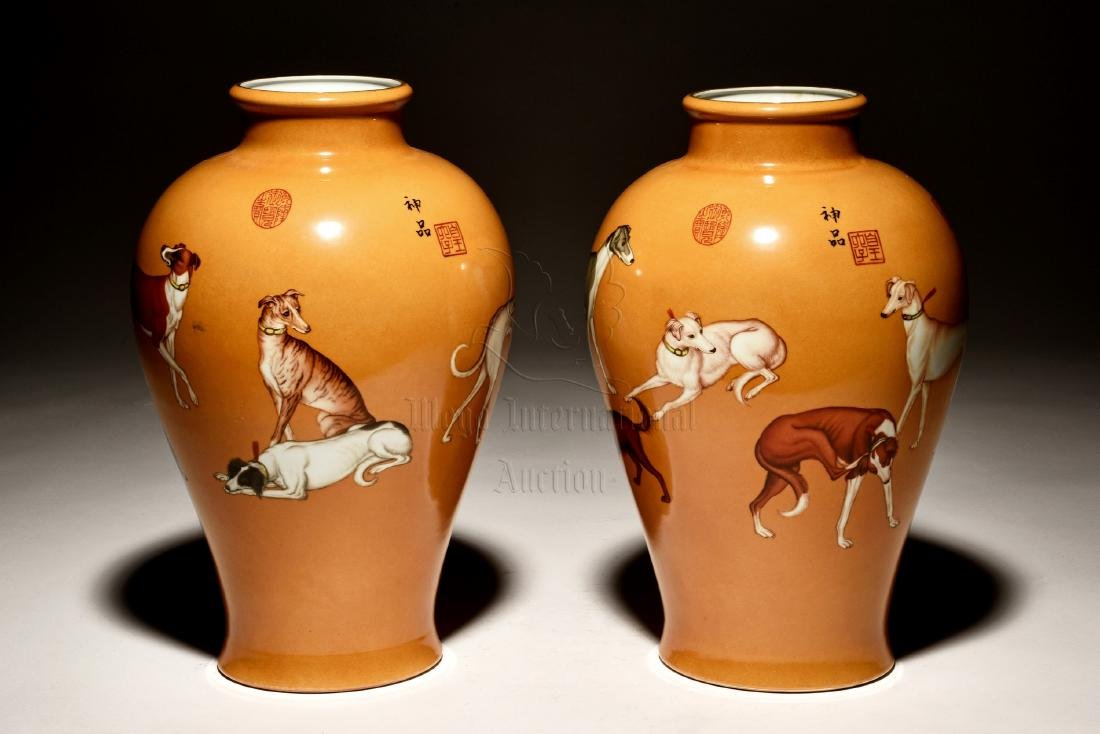 PAIR OF FAMILLE ROSE 'DOGS' VASES