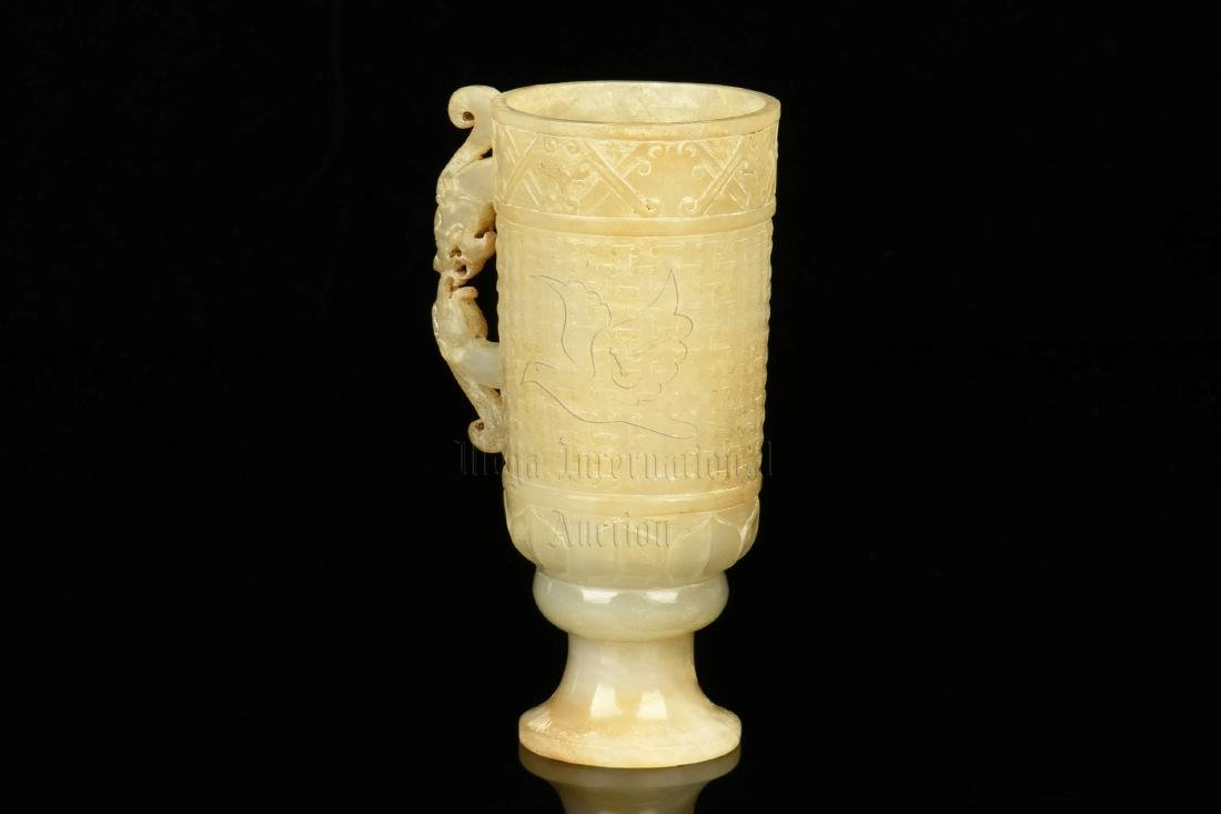 WHITE JADE CARVED ARCHAIC STYLE 'DRAGON' CUP