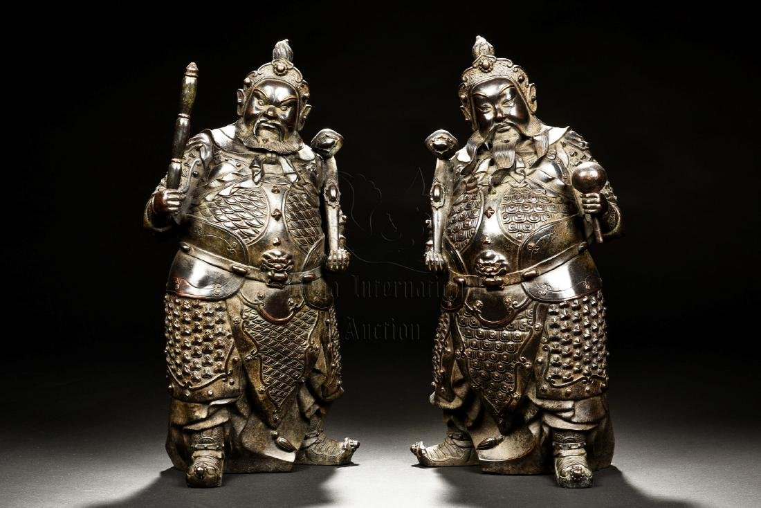 PAIR OF IRON CAST 'WARRIORS' FIGURES