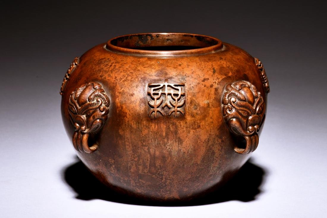 BRONZE JAR WITH INSCRIPTION AND FOUR HANDLES