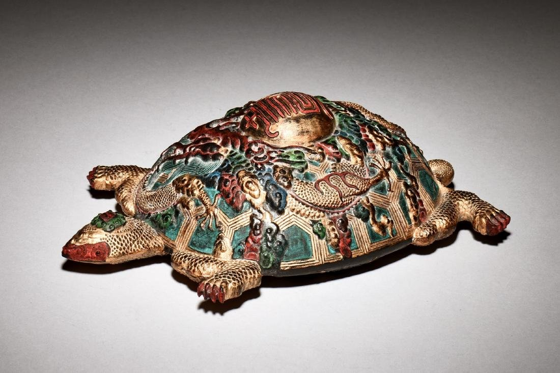 GILT AND PAINTED 'MYTHICAL TURTLE' INKSTONE