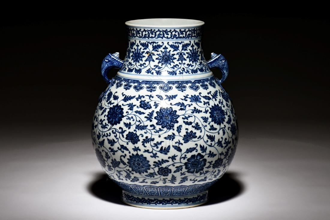 BLUE AND WHITE 'FLOWERS' JAR WITH ELEPHANT HANDLES