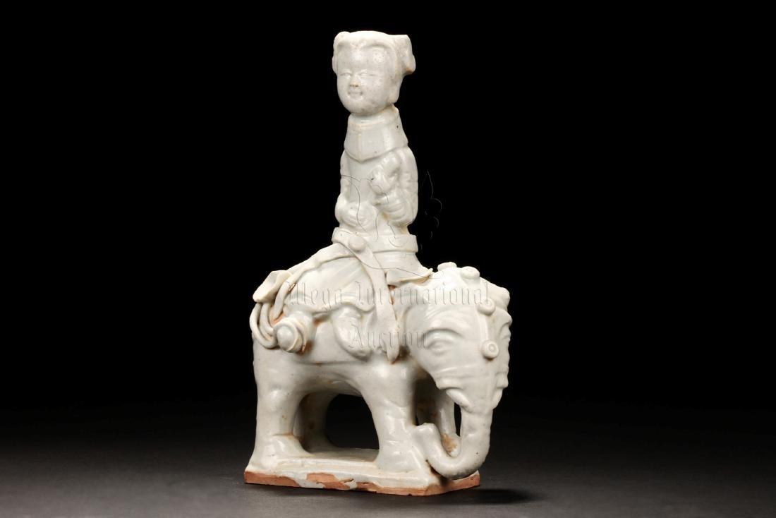 WHITE GLAZED 'CHILD AND ELEPHANT' FIGURE