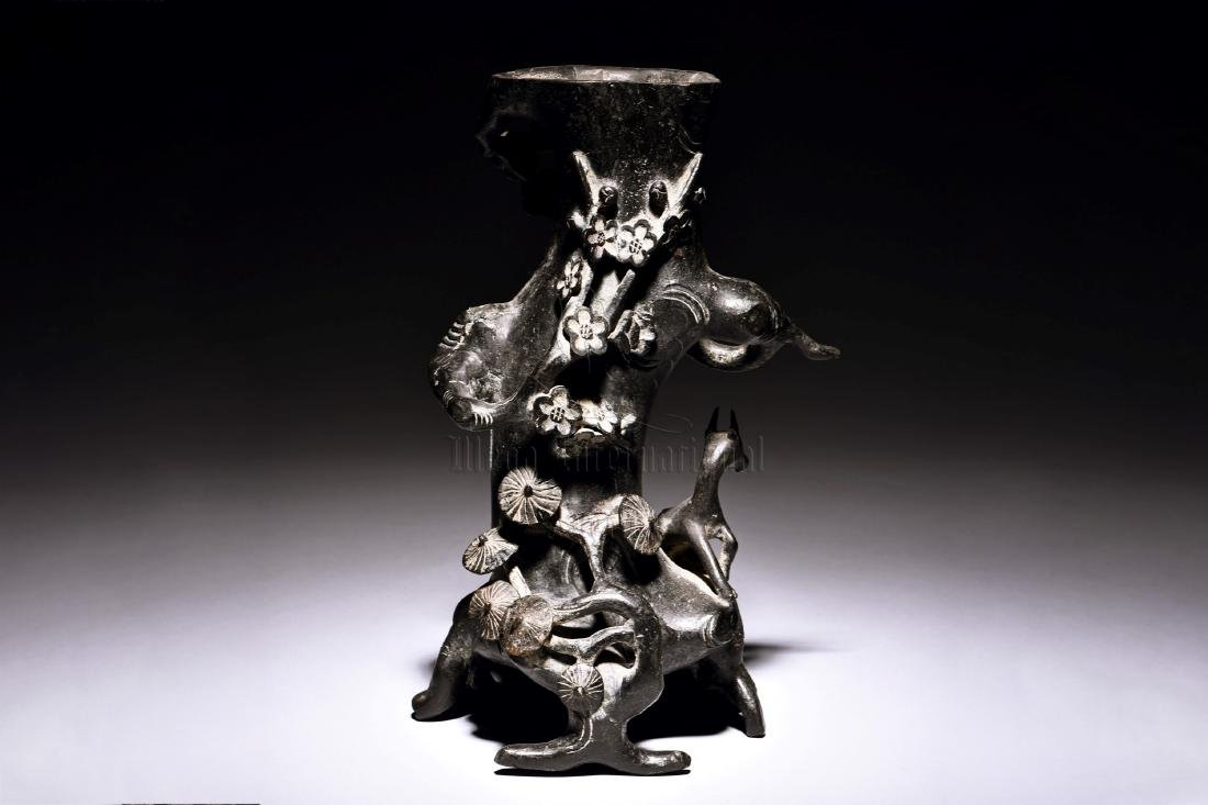 A CHINESE CARVED IRON PLUM BLOSSOM TREE TRUNK