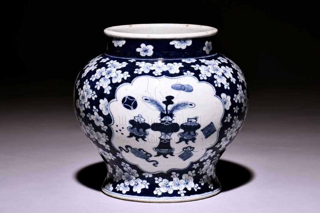 A KANGXI PERIOD JAR DECORATED WITH PLUM FLOWERS IN AN