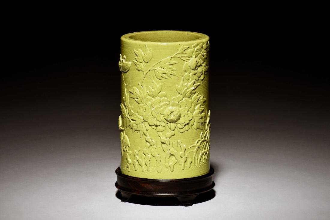 GREEN GLAZED AND CARVED 'FLOWERS' BRUSH POT WITH STAND
