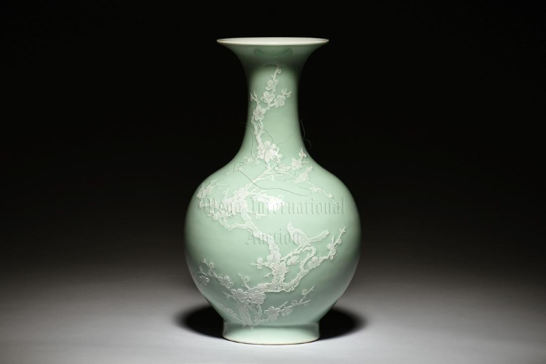 CELADON GLAZED 'PLUM FLOWERS' BOTTLE VASE