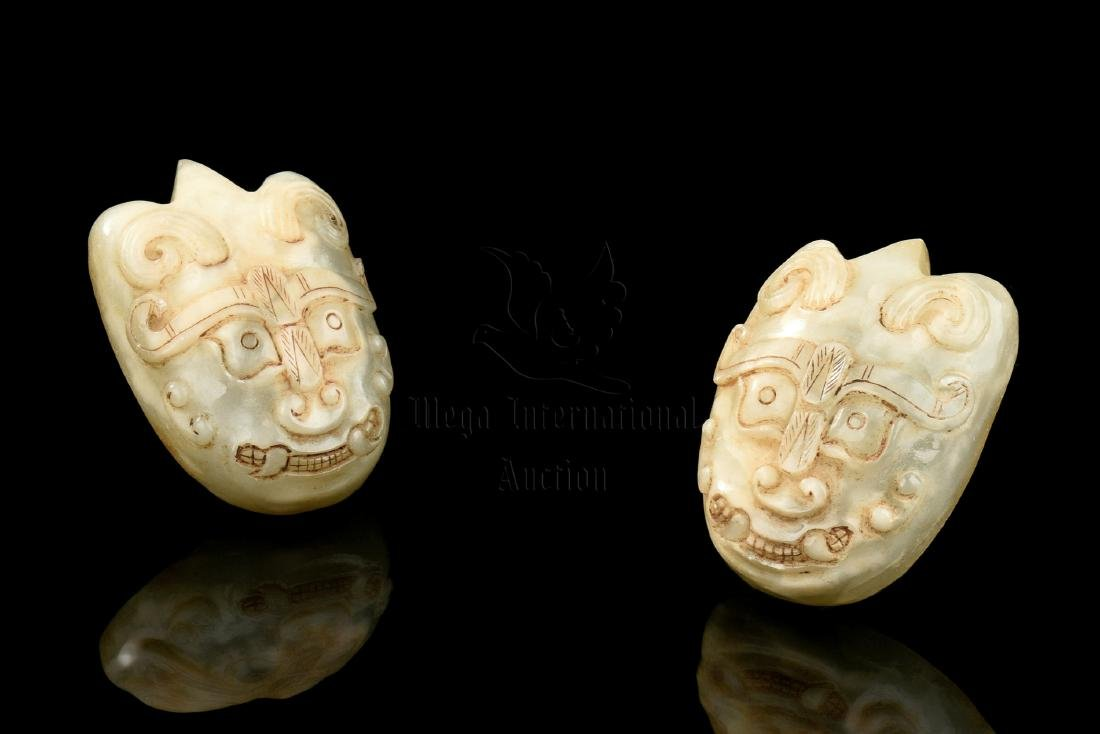 PAIR OF JADE CARVED 'MASK' ORNAMENTS