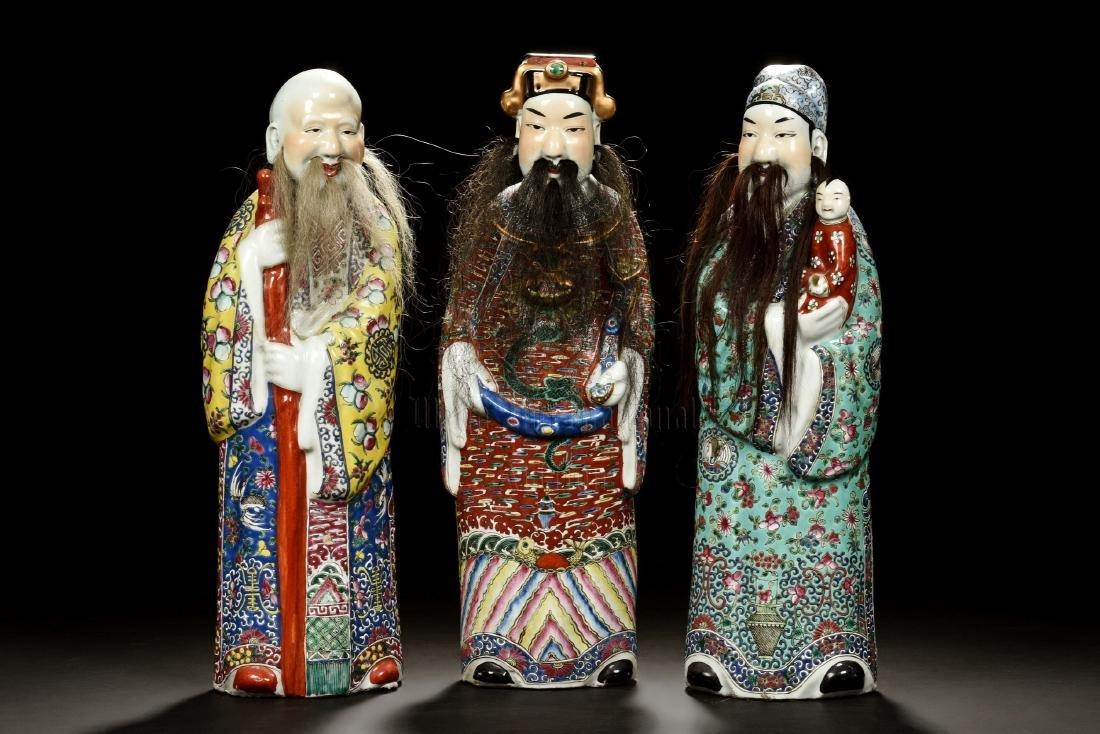SET OF THREE FAMILLE ROSE 'FU LU SHOU' FIGURES