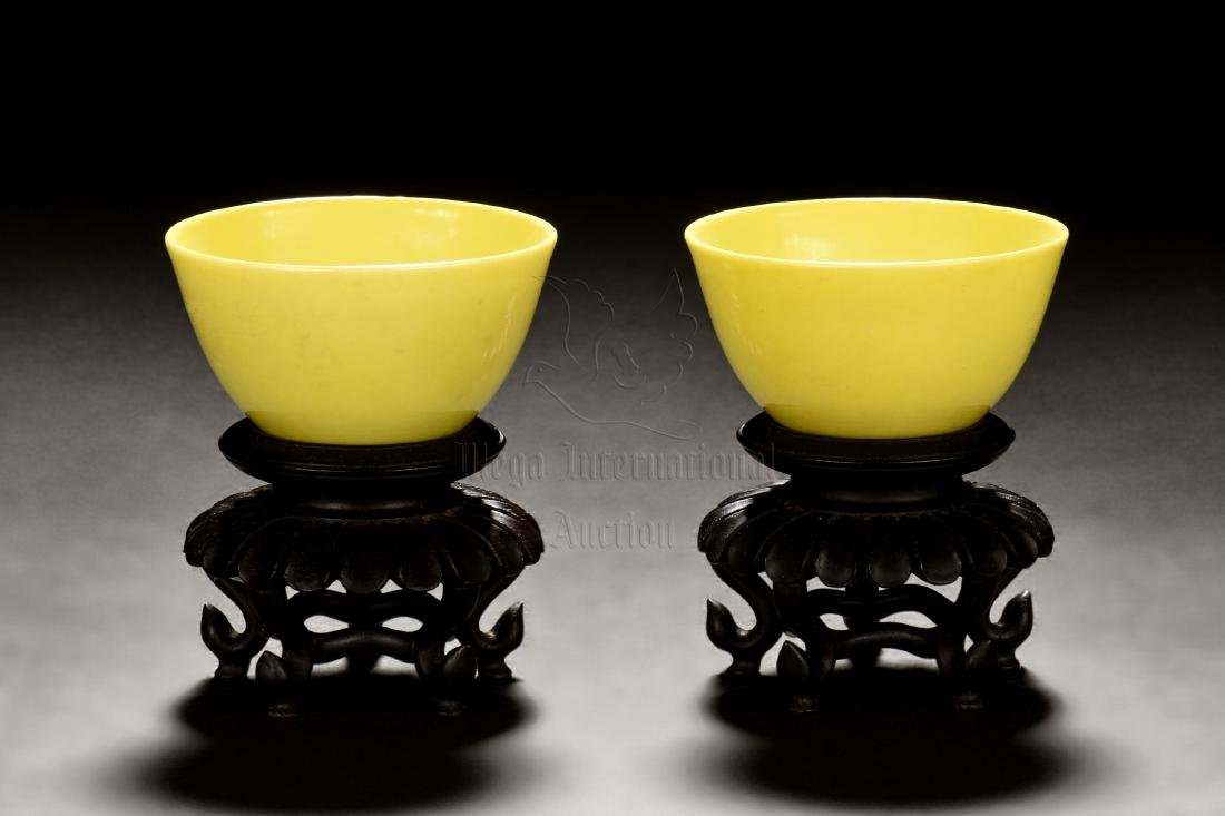 PAIR OF LEMON YELLOW GLAZED CUPS WITH WOODEN STANDS