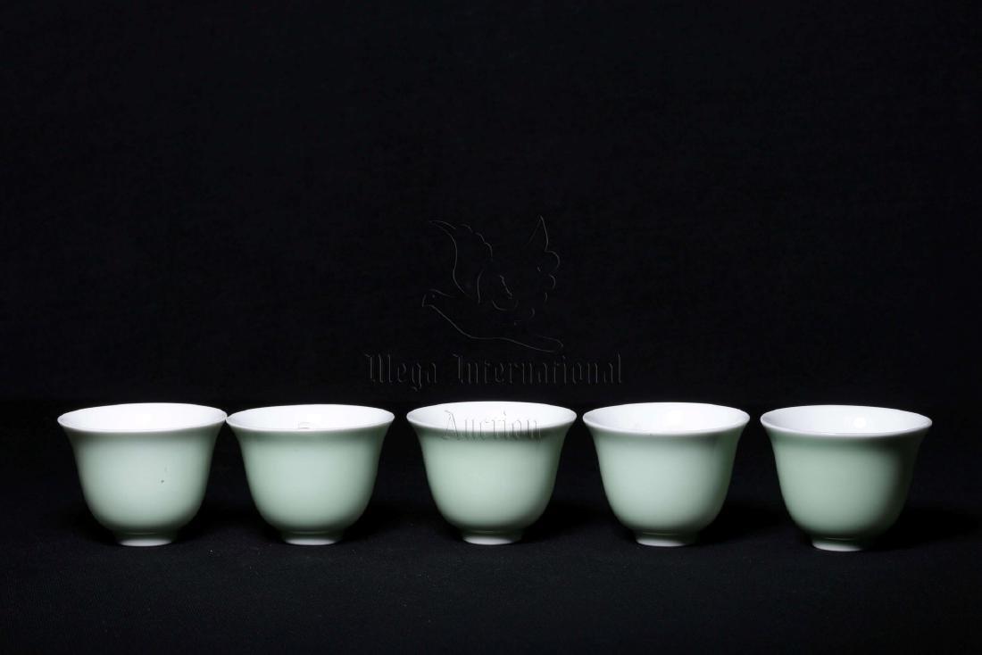 SET OF FIVE CELADON GLAZED CUPS