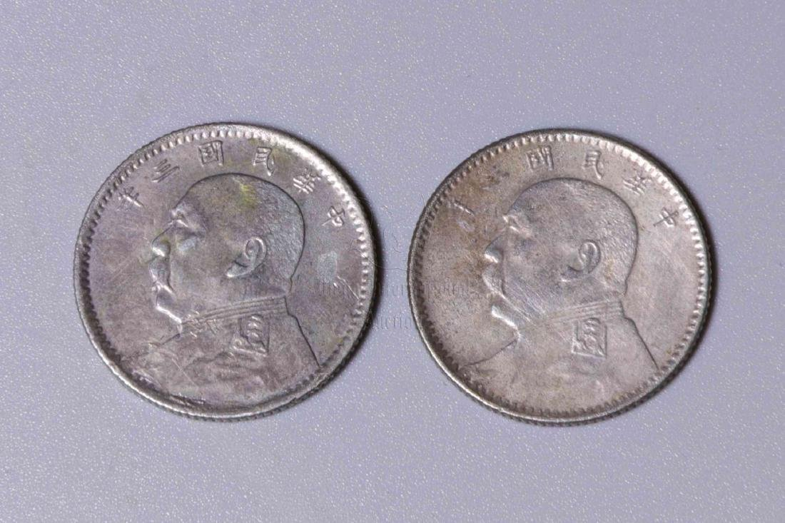 TWO CHINESE SILVER COINS