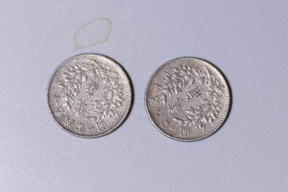 TWO CHINESE SILVER COINS - 2