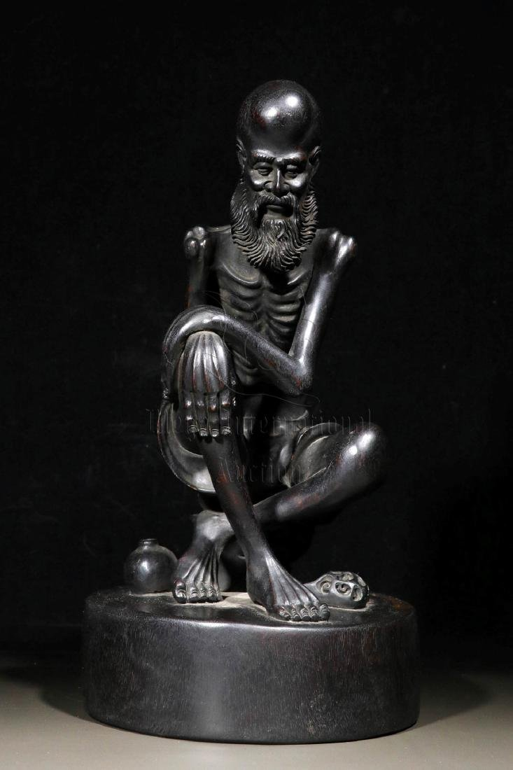 ZITAN WOOD CARVED 'RIBBED LUOHAN' FIGURE