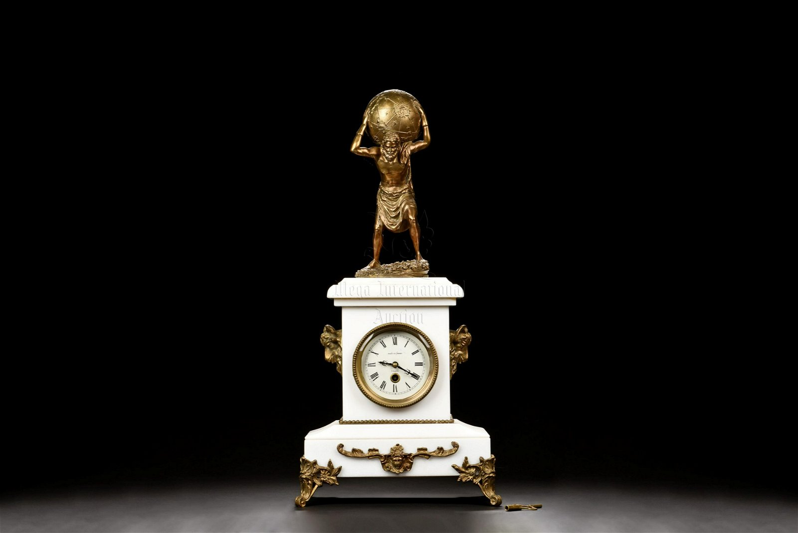 FRENCH GILT AND MARBLE ATLAS CLOCK