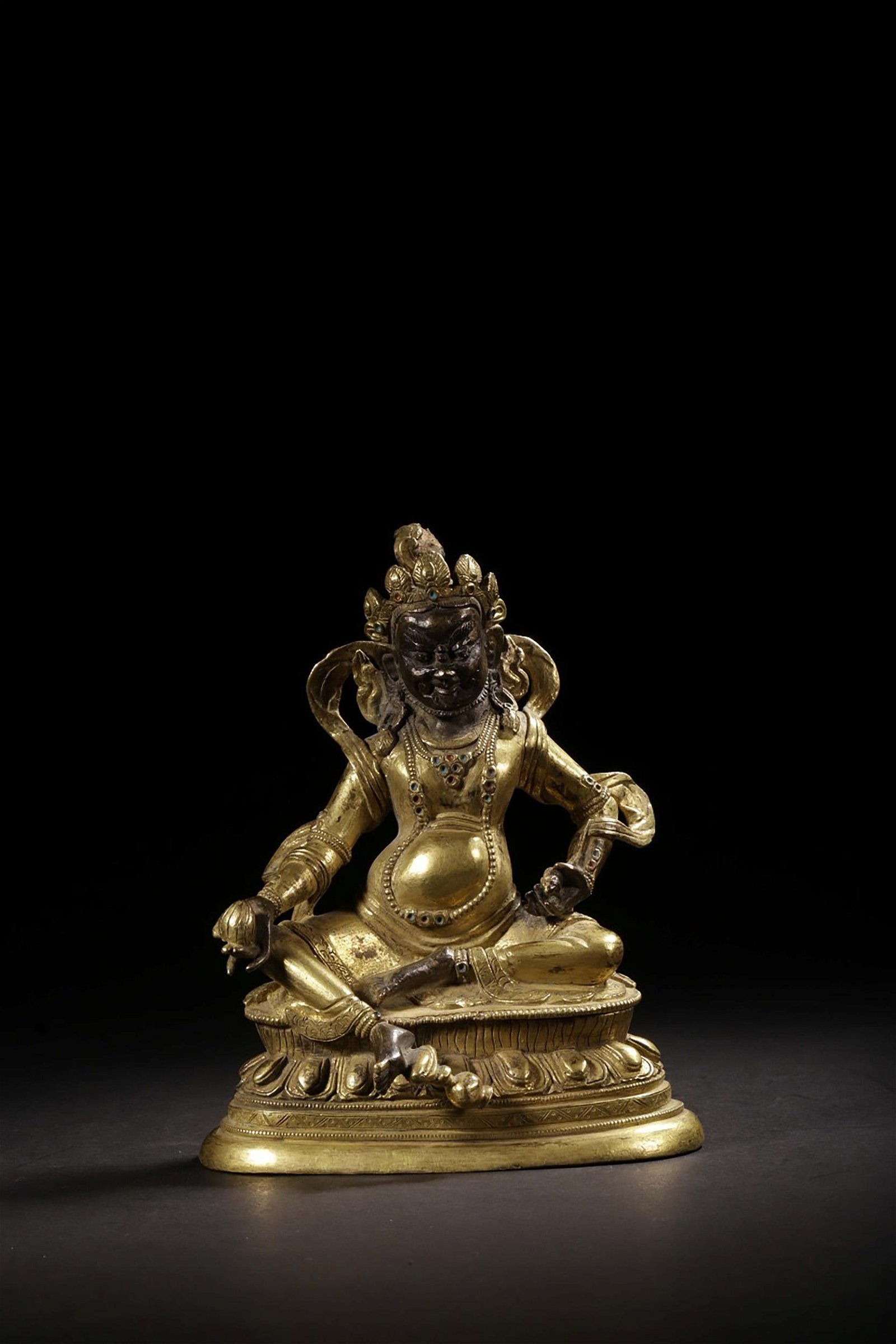 GILT BRONZE CAST 'YELLOW JAMBHALA' SEATED FIGURE