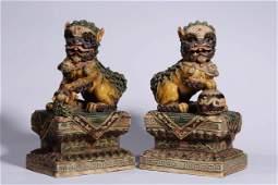 A PAIR OF CHINESE TRICOLOUR PORCELAIN LION ORNAMENT