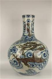 QING DYNASTY BLUE WHITE AND IRON RED DRAGON BOTTLE VASE