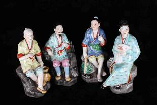 A SET OF FOUR CHINESE FIGURE ORNAMENTS IN THE FIFTIES