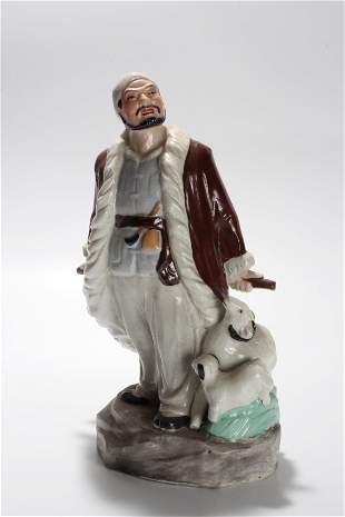 A CHINESE PORCELAIN FIGURE ORNAMENT IN THE SIXTIES