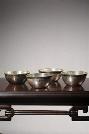 SET OF FOUR SILVER BOWLS