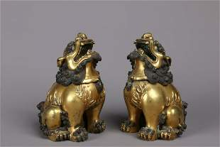 PAIR OF GILT BRONZE CAST 'MYTHICAL LIONS' FIGURES