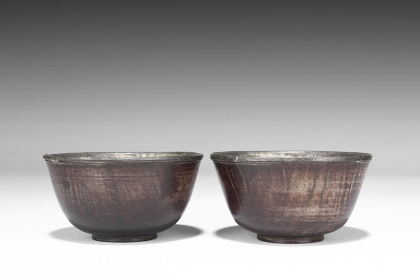 A PAIR OF CARVED ROSEWOOD BOWLS WITH SILVER INSET