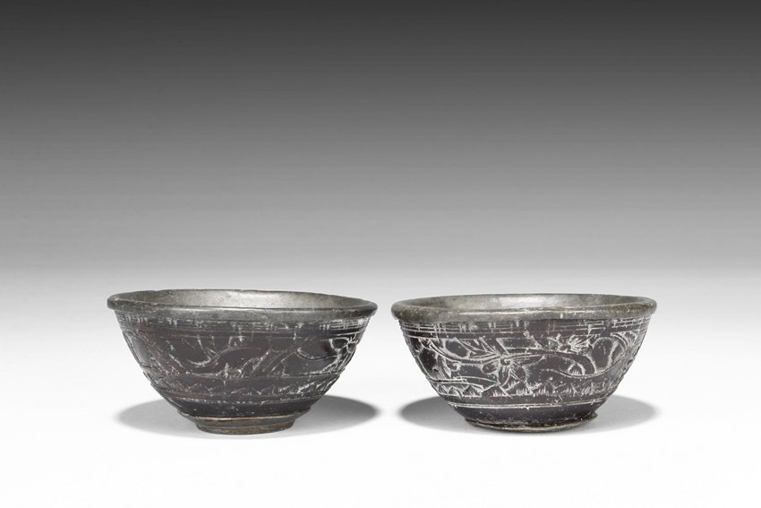 A PAIR OF CARVED COCONUT BOWLS WITH TIN INSET