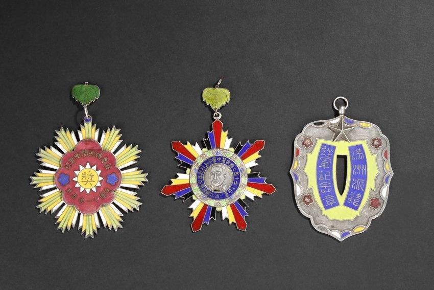 A SET OF THREE INSCRIBED SILVER ENAMELED BADGES