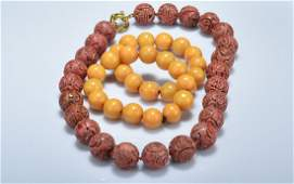 TWO AMBER BRACELETS & CARVED CORAL PRAYER BEADS