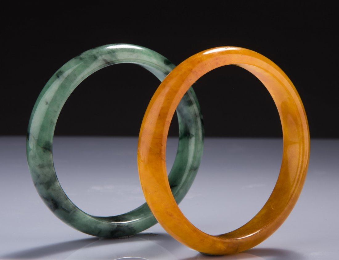 GROUP OF TWO (2) JADEITE BANGLES