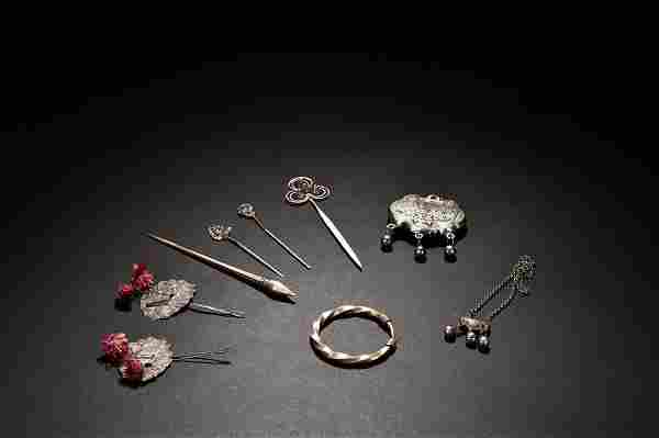 GROUP OF NINE SILVER ORNAMENTS AND HAIRPINS