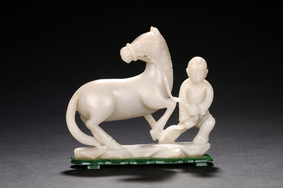 WHITE JADE CARVED 'HORSE AND CHILD' FIGURE