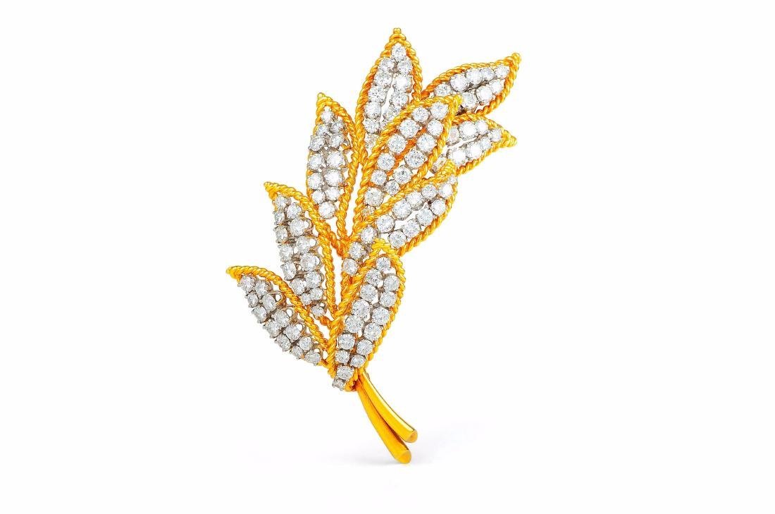 A Platinum, Gold, and Diamond Leaf Brooch