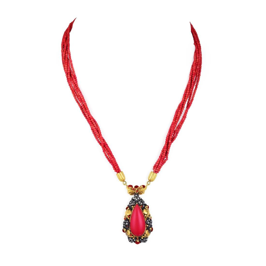 A Gold and Coral Pendant Necklace