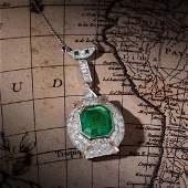A Large Colombian Emerald Diamond Pendant Necklace,