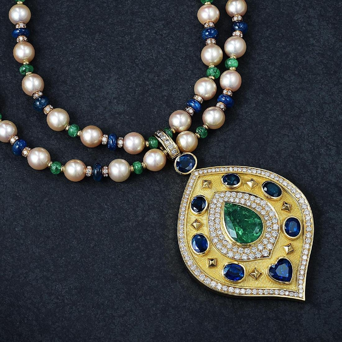An Emerald Sapphire Diamond and Pearl Pendant Necklace,