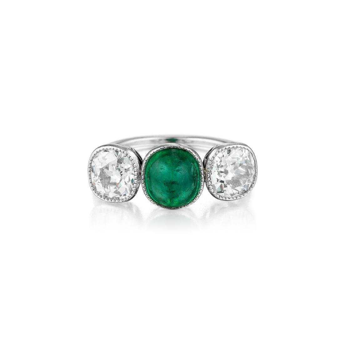 An Art Deco Platinum Emerald and Diamond Ring