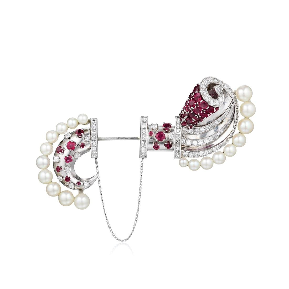 A Platinum and White Gold Ruby, Diamond and Cultured