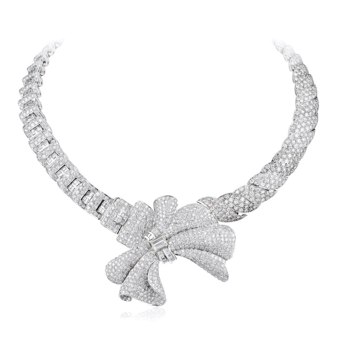 A Platinum Diamond Necklace and Brooch/Enhancer Set