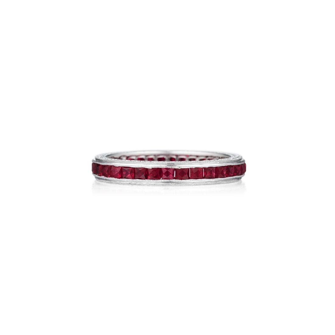 An 18K White Gold Ruby Band
