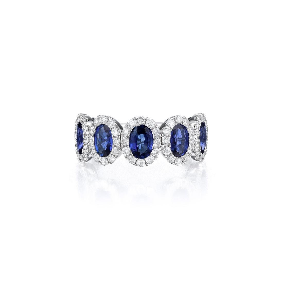 An 18K White Gold Sapphire and Diamond Ring