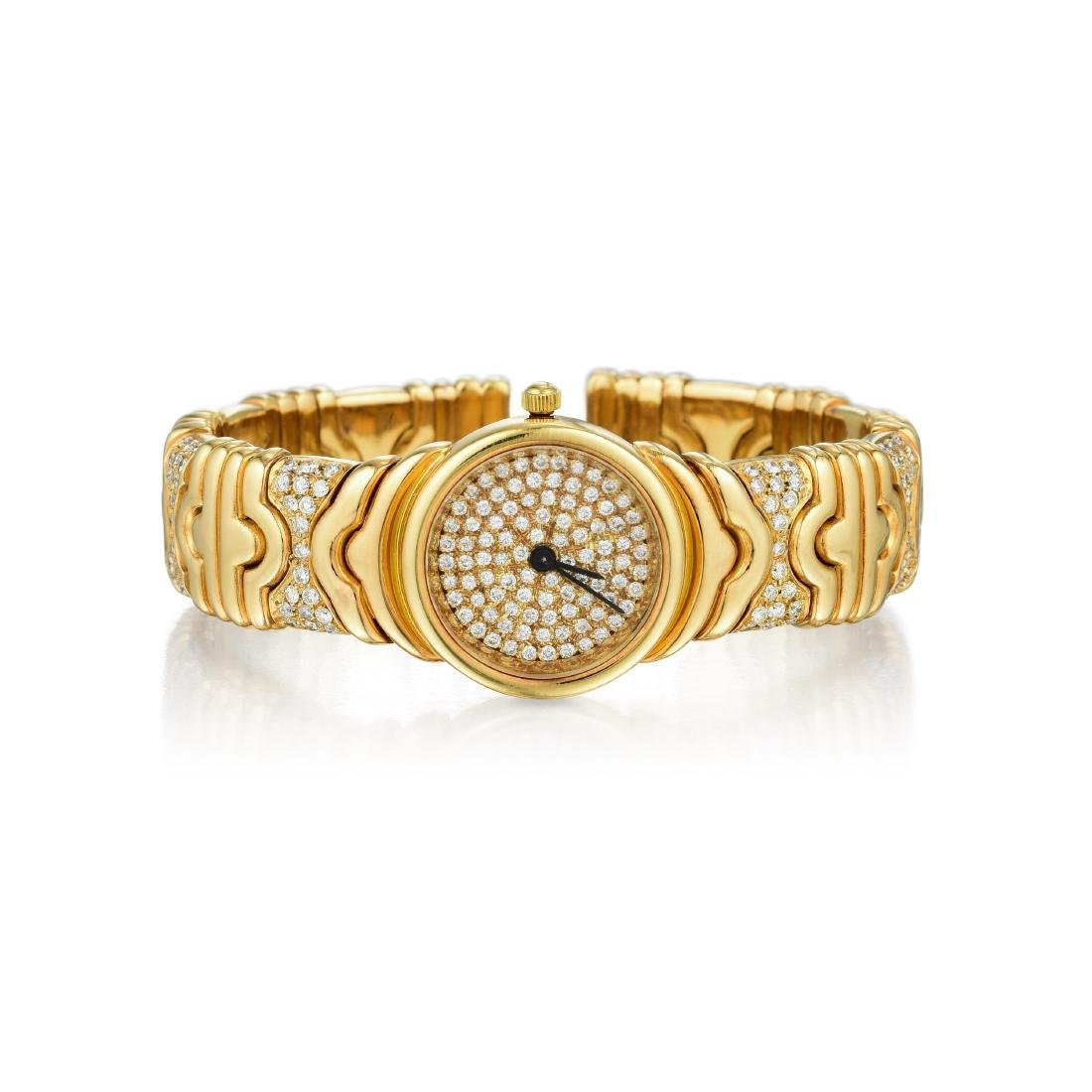 An 18K Gold Diamond Bangle Watch