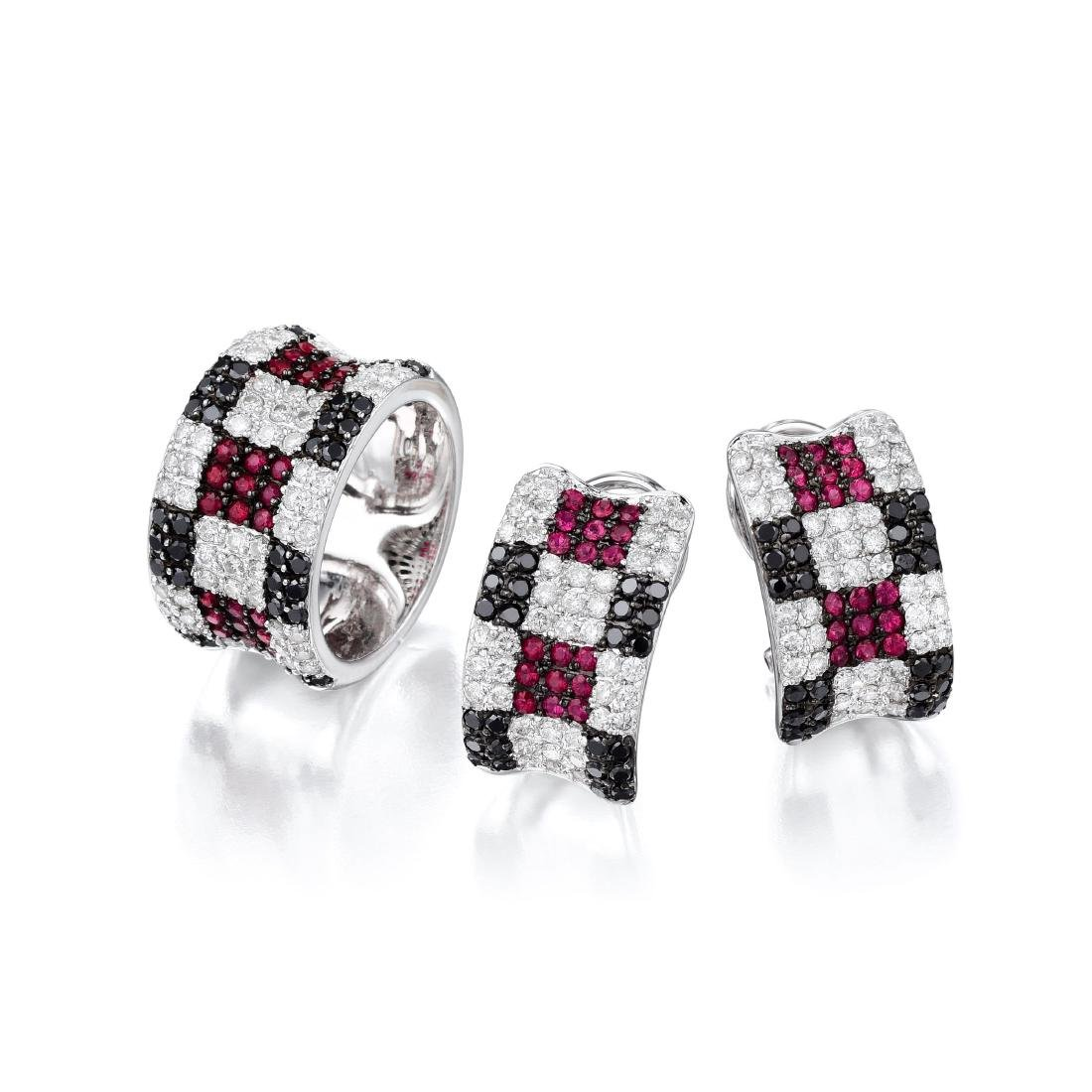An 18K White Gold Diamond Ruby and Sapphire Set