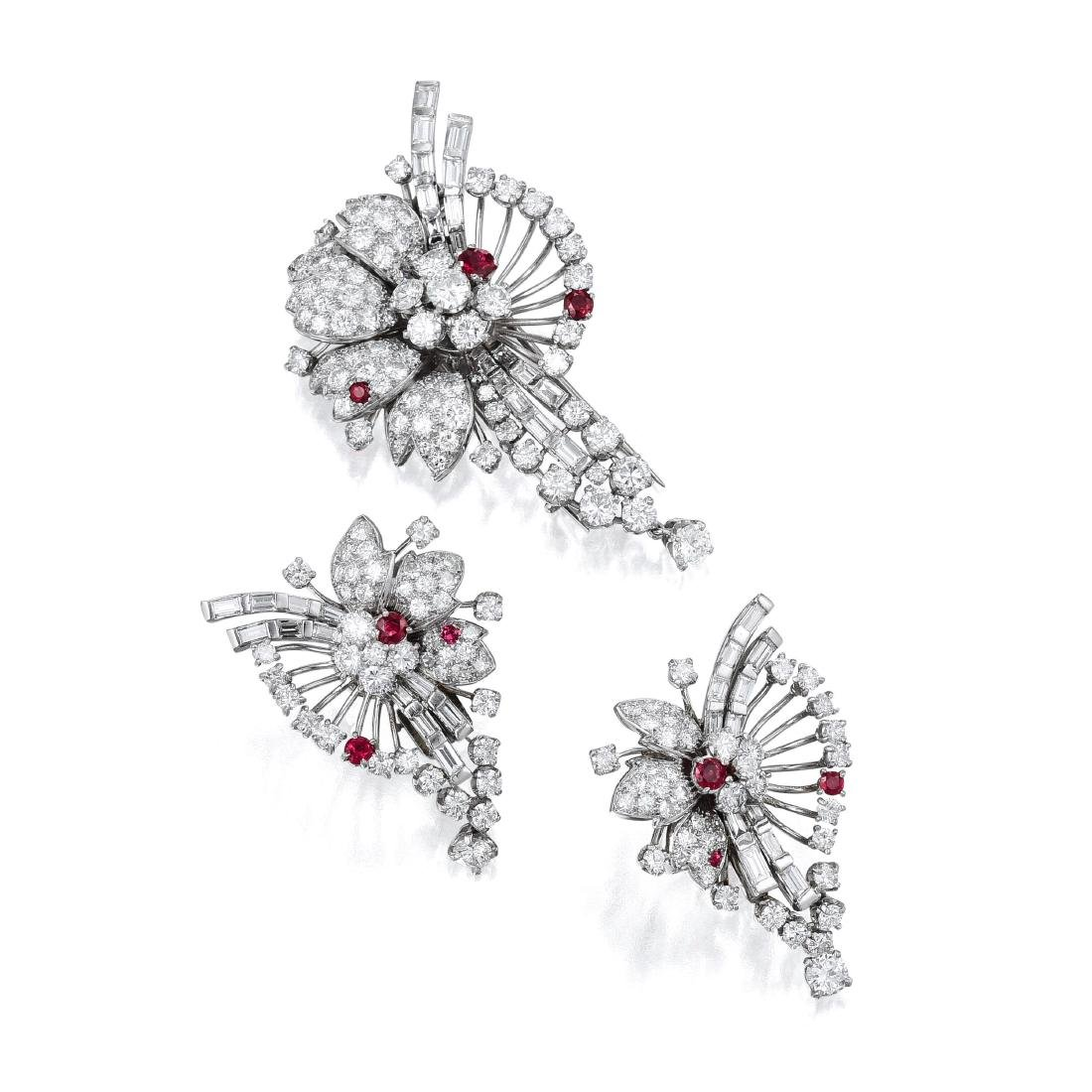 A Platinum Diamond and Ruby Ear Clip and Brooch Set