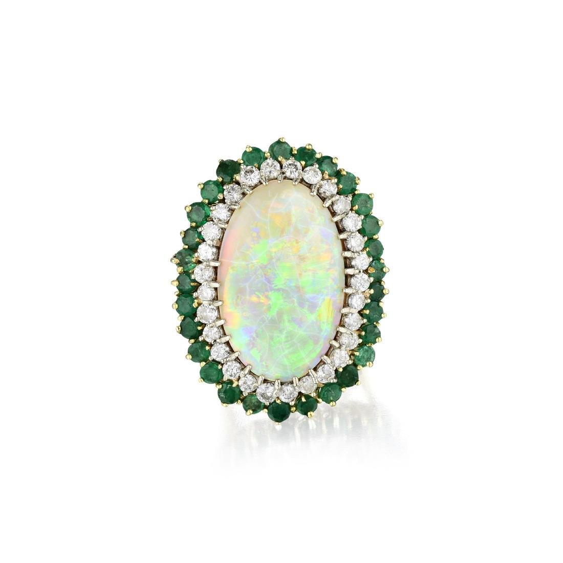 An 18K Gold, Opal, Emerald and Diamond Ring