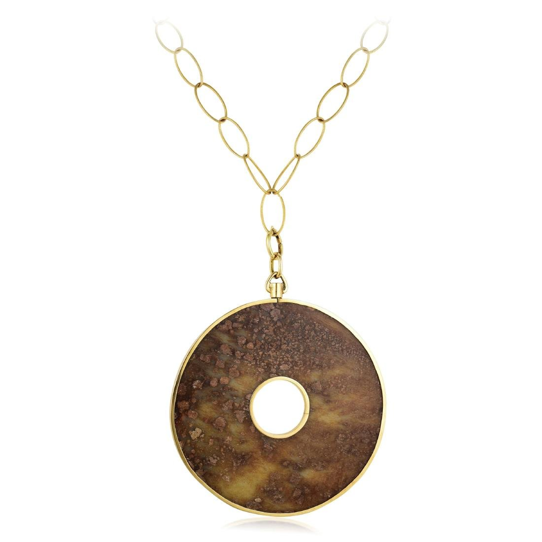 A 14K Gold and Jade Pendant Necklace