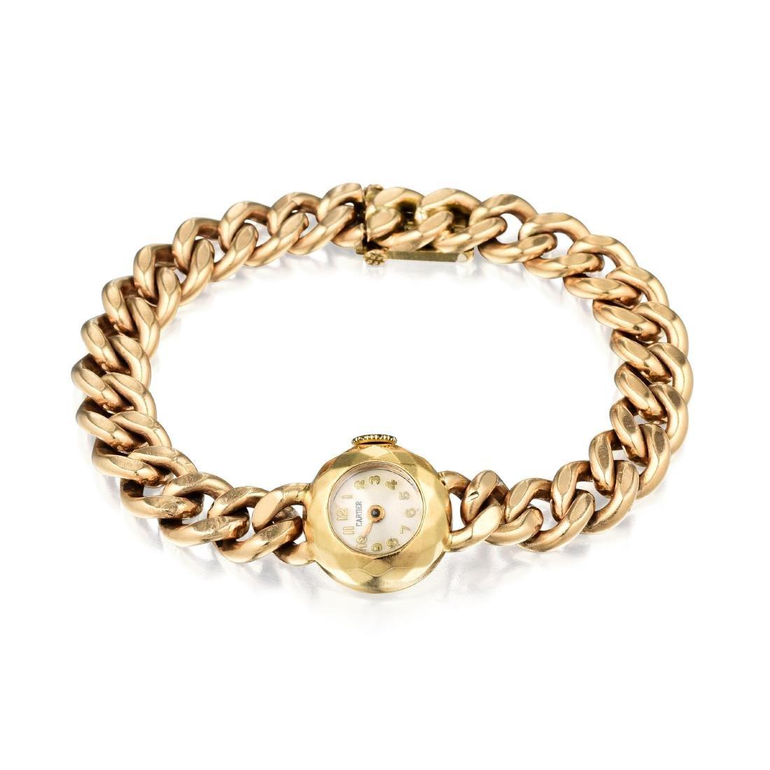 A Cartier Gold Watch by J. Schulz