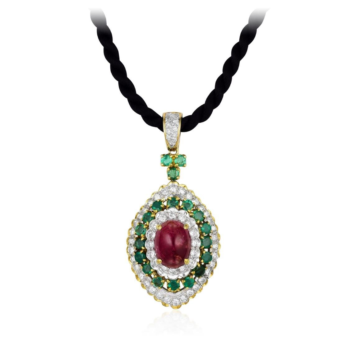 A Ruby Emerald and Diamond Pendant