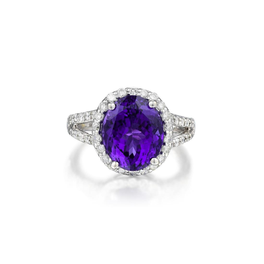 A 14K White Gold Tanzanite and Diamond Ring